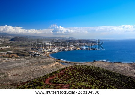 View of the city of El Medano with the top of the mountain Punta Roja, Tenerife, Canary Islands, Spain. - stock photo