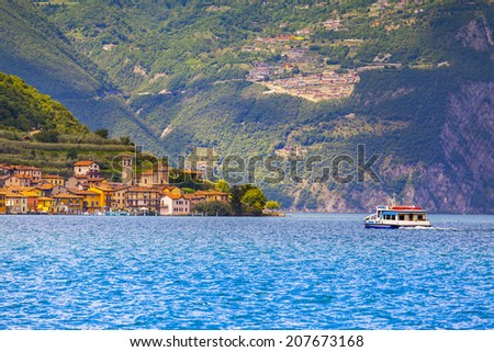 View of the city Peschiera Maraglio, a bright sunny day. Italy, the Alps, Lake Iseo. - stock photo