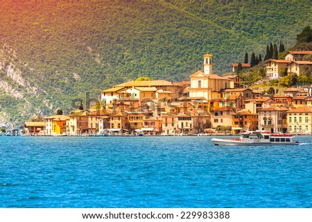 View of the city Peschiera Maraglio, a bright sunny day. Region Lombardy, Province Brescia (BS) in Iseo Lake. Italy, Europe. - stock photo
