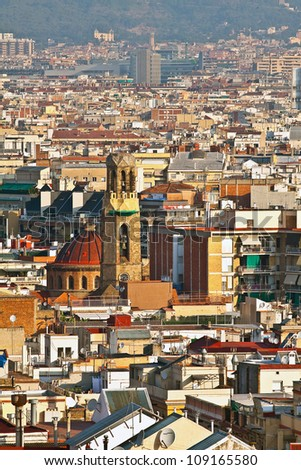 View of the city with Catholic church in the morning sun (Barcelona city, Spain, Europe)