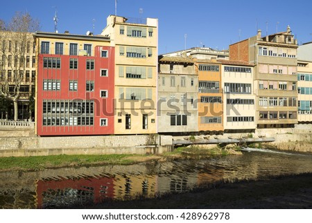 View of the colorful houses next to Onyar river, in the old quarter of Girona. Catalonia