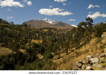 view of the cordillera blanca in Peru with a typical andean patchwork - stock photo