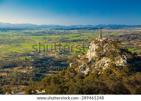 view of the cross on the hillside at the Santuario de San Salvador, Majorca, Spain - stock photo