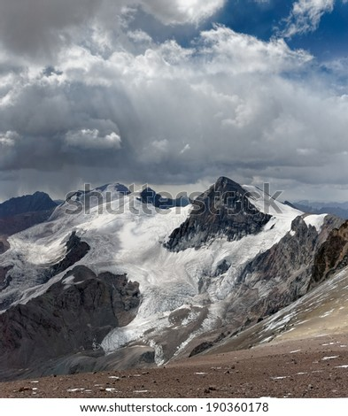 View of the Cuerno Mountain from Aconcagua mountain at 5500 meters. Aconcagua Provincial Park, Mendoza, Argentina, South America. - stock photo