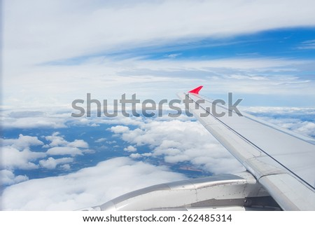 view of the cumulus clouds.photo from the window of an airplane  - stock photo