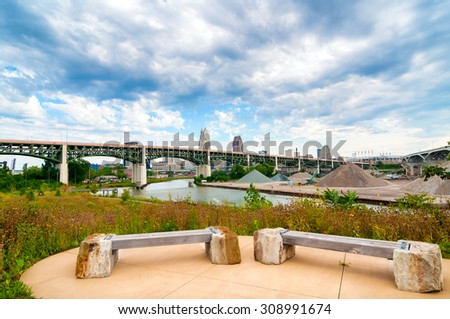 View of the Cuyahoga River from Scranton Flats near downtown, between two major highway bridges - stock photo