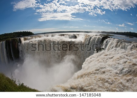 """View of the """"Devil's Throat"""" through the """"fish-eye"""" with the Argentine side of Iguassu Falls - stock photo"""
