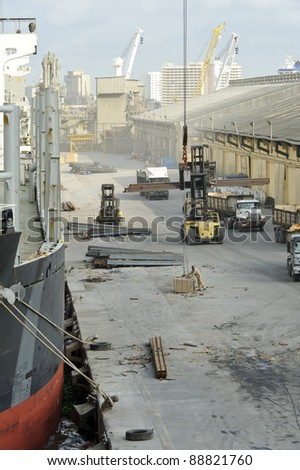 View of the docks while unloading a ship - stock photo