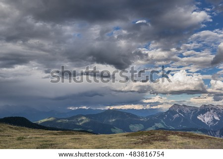 View of the Dolomites mountains seen from Monte Muro refuge, high above Passo delle Erbe, on a cloudy summer evening, Val Badia, Val di Funes, Trentino, Alto-Adige, South TYrol, Italy