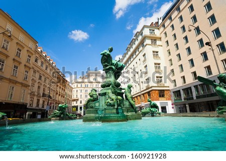 View of the Donnerbrunnen fountain in Vienna, Austria with sculptures on sunny day - stock photo