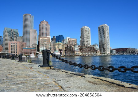 View of the downtown Boston skyline along the harbor. - stock photo