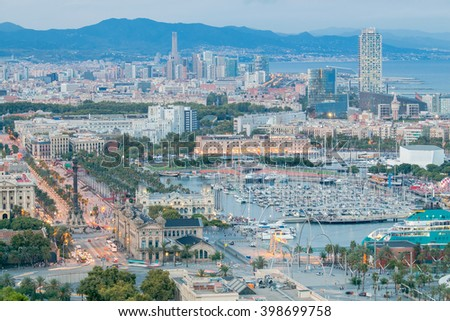 View of the embankment, and a column of Columbus in Barcelona on the sunset. - stock photo
