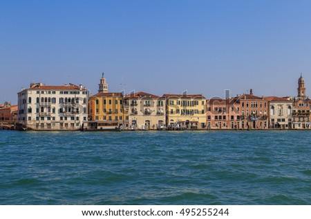 View of the embankment of the Giudecca canal in Venice, summer day