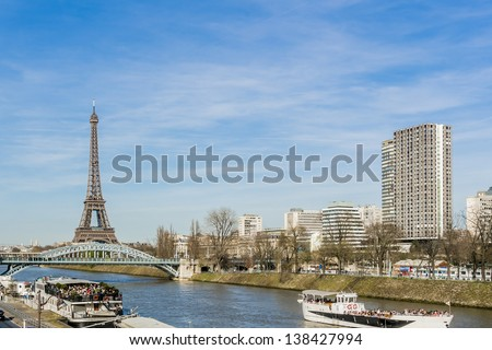 View of the embankment of the river Seine with Eiffel Tower (La Tour Eiffel). Paris, France, Europe - stock photo