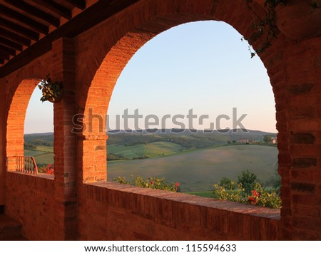 View of the evening Siena countryside from the arched brick terrace
