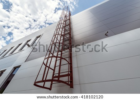 View of the exterior of the store building with the fire escape. - stock photo