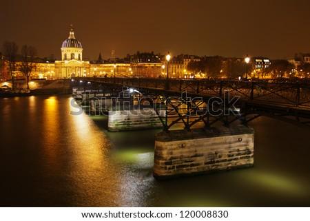 view of the famous bridge pont des arts in Paris by night - stock photo