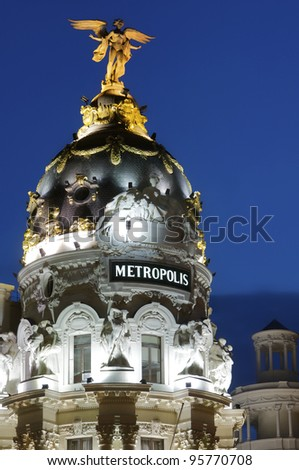 view of the famous Metropolis Building, located at the intersection of  Gran Via and Alcala, Madrid, Spain - stock photo
