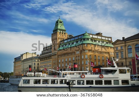 View of the famous scandinavian and north european city Stockholm - the capital of Sweden, with sightseeng boat