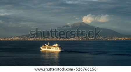 "View of the famous volcano ""Vesuv"" near Naples in Italy with a typical cruise ship during sunset"