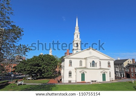 View of the First Baptist Church in America and partial skyline of Providence, Rhode Island, from College Hill against a bright blue sky - stock photo