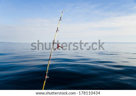 View of the fishing rod from the boat or the shore