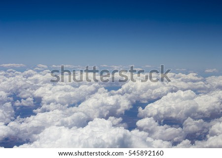 View of the  fluffy white cumulus clouds flying to  Broome, North Western Australia by aeroplane  on a cloudy afternoon in the summer Wet Season is beautifully exhilarating.