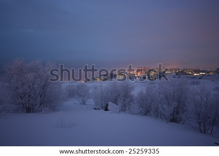 view of the foggy Murmansk in the winter dusk - stock photo
