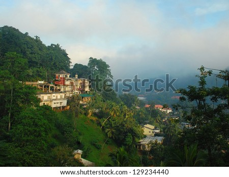 View of the foggy town of Kandy in Sri Lanka under conditions of low visibility - stock photo