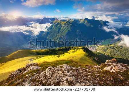 View of the foggy Val di Fassa valley with passo Sella. National Park. Dolomites, South Tyrol. Location Canazei, Campitello, Mazzin. Italy, Europe. - stock photo
