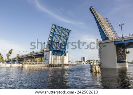 View of the Fort Lauderdale Intracoastal Waterway from a water taxi with a drawbridge ahead - stock photo