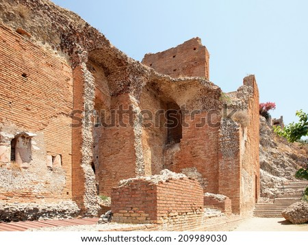 View of the fragments of the remains of an ancient Greek theater on the Italian island of Sicily, Italy, in town Taormina  - stock photo