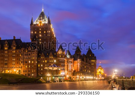 View of the Frontenac Castle and Dufferin Terrace at twilight, Quebec City, Quebec, Canada. The castle is a grand hotel and the most famous landmark of Quebec City. - stock photo
