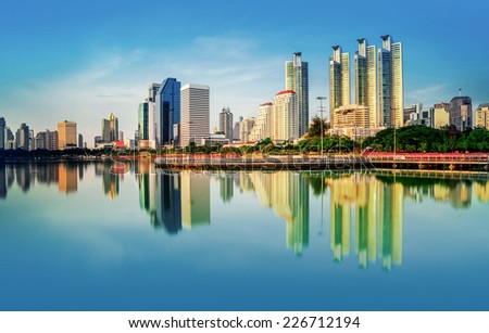 View of the garden city with skyscrapers and reflection in river Modern city in the evening in Bangkok Thailand. - stock photo