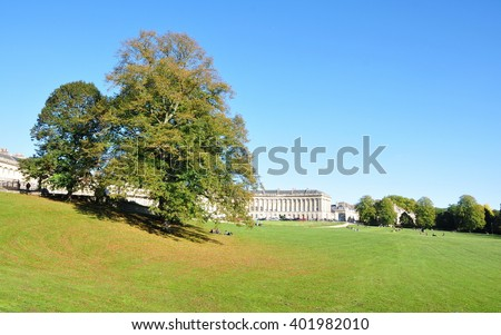 View of the Georgian Era Royal Crescent Seen from Victoria Park in the City of Bath in Somerset England - stock photo