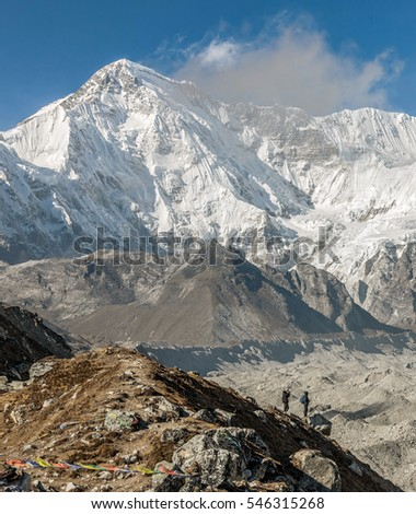 View of the glacier Gokyo with peaks Cho Oyu (8201 m) on a sunny day - Gokyo region, Nepal, Himakayas