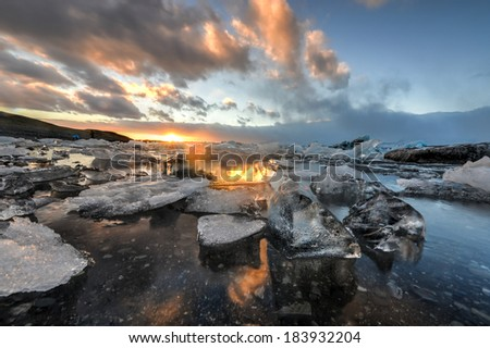 View of the glacier lagoon, Jokulsarlon, Iceland at sunset. Jokulsarlon is a large glacial lake in southeast Iceland, on the edge of Vatnajokull National Park. - stock photo