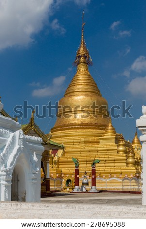 View of the golden Kuthodaw Pagoda in Mandalay. - stock photo