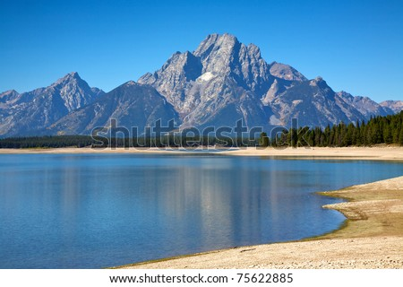 View of the Grand Teton Mountains from the shores of Jackson Lake. Grand Teton National Park, Wyoming, United States.