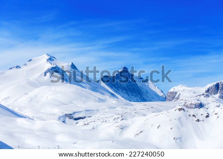 View of the Grande Motte mountain and blue sky with clouds.