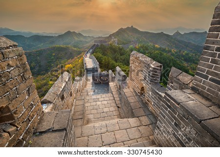 View of the Great Wall of China during beautiful sunset - stock photo