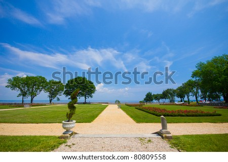 View of the grounds, looking towards the Long Island Sound, from historic Gold Coast Mansion, the Hempstead House at Sands Point Preserve NY - stock photo