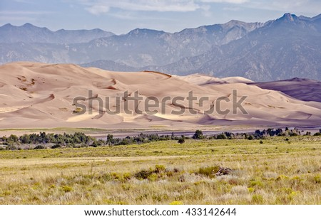 View of the high dunes in the Great Sand Dunes National Park and Preserve near Alamosa, Colorado, with the Sangre de Cristo Mountains in the background - stock photo