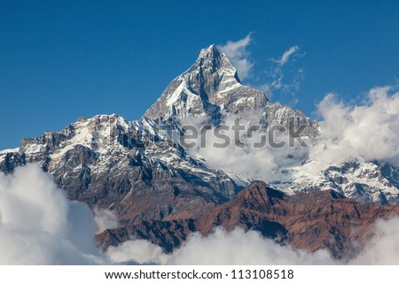 View of the himalayan peak Machhapuchre from the south (view from the motor hang-gliding) - Nepal, Himalayas - stock photo