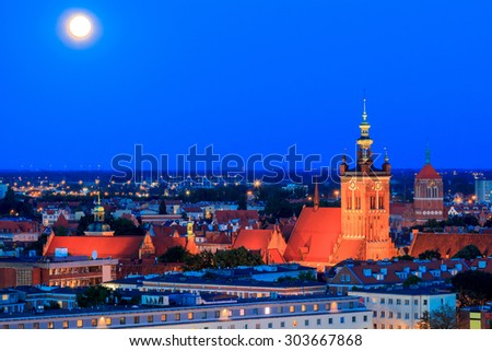 View of the historic center of Gdansk and the Church of St. Catherine at night. - stock photo