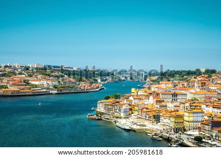 View of the historic city of Porto, Portugal with the Dom Luiz bridge. - stock photo