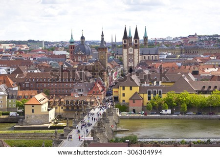 View of the historic city Wuerzburg, region of Franconia, Northern Bavaria, Germany. The town is located on the Main River. In foreground is seen the old Main Bridge. In background are seen churches. - stock photo