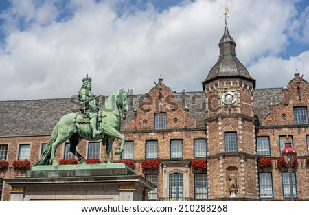 """View of the historic town-hall and the memorial of the Elector """"Jan Wellem"""" in Dusseldorf in Germany - stock photo"""