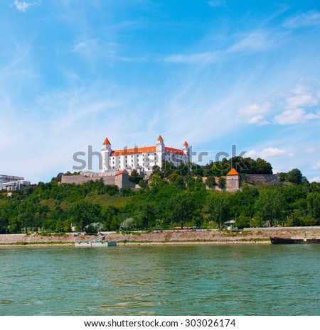 View of the historical center and castle in Bratislava in the sunny summer day - stock photo