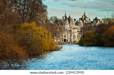 View of the Household Cavalry Museum and London Eye view from St. James Park - stock photo